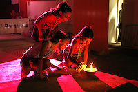Taking care of the flame... Banquet finishes at 2006 Portimao World Cup of Rhythmic Gymnastics on September 10, 2006.  (Photo by Tom Theobald)  Photo note:  This came at the very end and were the last frames from my camera.  The banquet was just finishing. I thought long time what to call the images...because for me they are kind of special.  They were young maidens taking care of the candles (I think juniors that were in the gala earlier).  What can the flame be?  The flame of rhythmic... Flame of Portimao (til next World Cup)...  Flame of the Olympic dream of every gymnast...