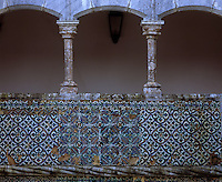 A close-up of the multi-coloured and geometric 6th century Mudejar tiles which line the walls of the Manueline cloister