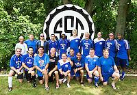 Men's amateur master soccer team photo.