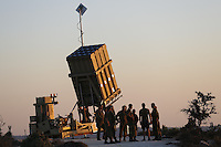 "Israeli soldiers stand near an ""Iron Dome"" battery, a short-range missile defence system, designed to intercept and destroy incoming short-range rockets and artillery shells, near Jerusalem on September 9, 2013 as the United States lobbied for domestic and international support for military strikes against Syria. Photo by Oren Nahshon"