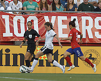 USWNT midfielder Heather O'Reilly (9) brings the ball forward as Korea Republic midfielder Lee Sejin (5) closes. In an international friendly, the U.S. Women's National Team (USWNT) (white/blue) defeated Korea Republic (South Korea) (red/blue), 4-1, at Gillette Stadium on June 15, 2013.
