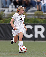 Harvard University midfielder Lauren Urke (20) brings the ball forward. In overtime, Harvard University defeated Yale University,1-0, at Soldiers Field Soccer Stadium, on September 29, 2012.