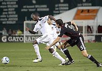 Dejan Jakovic #5 of D.C. United chases after Edson Buddle #14 of the Los Angeles Galaxy during an MLS match at RFK Stadium on July 18 2010, in Washington D.C. Galaxy won 2-1.