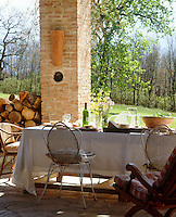 A table on the terrace is laid for a simple lunch