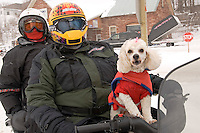 Snowmobilers Bill and Faye Hassee of Georgia ride with their poodle Bitsy during a tour of Michigan's Upper Peninsula.
