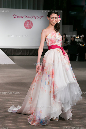 A model wearing fashion brand ''La Reine'' walks down the runway during the Special Dress Collection organised by 25 ans Wedding on November 1, 2015, Tokyo, Japan. The fashion magazine celebrates 30 years anniversary with a runway called Special Dress Collection in Roppongi Hills. (Photo by Rodrigo Reyes Marin/AFLO)