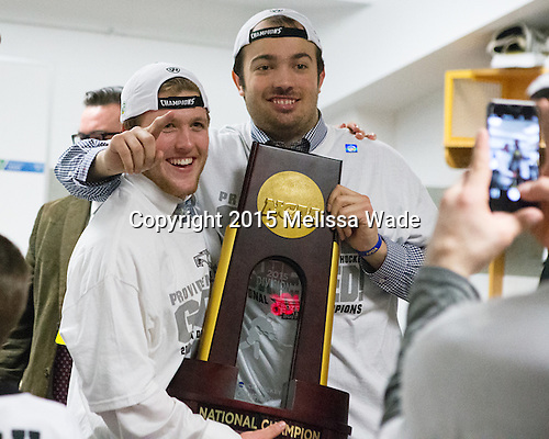 Robbie Hennessey (PC - 25), Truman Reed (PC - 23) - The Providence College Friars celebrated their national championship win after the Frozen Four final at TD Garden on Saturday, April 11, 2015, in Boston, Massachusetts.