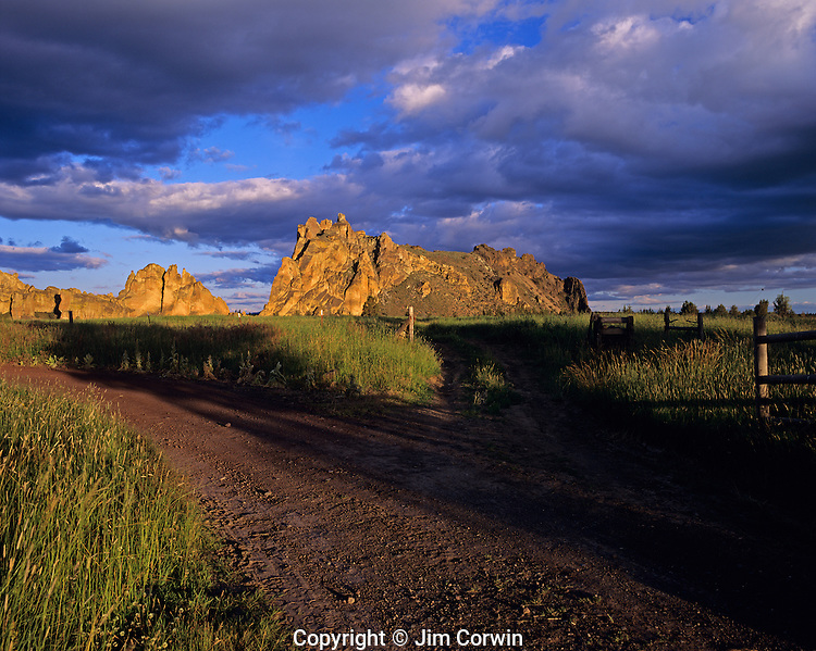 Smith Rock State Park sunset over rock formations with dirt gravel road Deschutes County Central Oregon State near Prineville Oregon USA