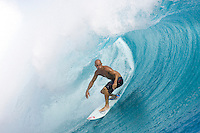 Ten times world professional surfing champion KELLY SLATER (USA)  riding ones of the world's most infamous waves,TEAHUPOO, Tahiti .  Photo: Joliphotos.com