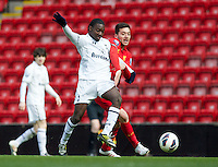 LIVERPOOL, ENGLAND - Easter Monday, April 1, 2013: Liverpool's Jose Ignacio 'Nacho' Huertas Ortiz in action against Tottenham Hotspur's Shaquile Coulthirst during the Under 21 FA Premier League match at Anfield. (Pic by David Rawcliffe/Propaganda)