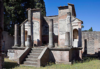 Temple of Isis, Pompeii, late 2nd century BC, showing stuccoed Corinthian columns with a temple on a podium in the center. The temple was rebuilt in opus latericium after the earthquake in 62AD