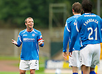 St Johnstone v Livingston...24.08.11   Scottish Communities League Cup Round 2.Jody Morris asks Francisco Sandaza and Murray Davidson who scored the first goal.Picture by Graeme Hart..Copyright Perthshire Picture Agency.Tel: 01738 623350  Mobile: 07990 594431