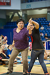 From left, Lorita Clough of Fairbanks battles Danielle Lord of Willow in the Indian Stick Pull at the Carlson Center in Fairbanks, Alaska.  Photo by Michael Dinneen