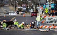 NWA Democrat-Gazette/JASON IVESTER<br /> A crew members from Seven Valleys Concrete in Cassville, Mo., replace bricks Thursday, Feb. 9, 2017, at the intersection of Walnut Street and 3rd Street in downtown Rogers. The block had been closed to make repairs to a water main break.