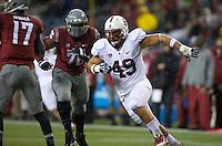 SEATTLE, WA - September 28, 2013: Stanford defensive end Ben Gardner rushes the quarterback during play against Washington State at CenturyLink Field. Stanford won 55-17