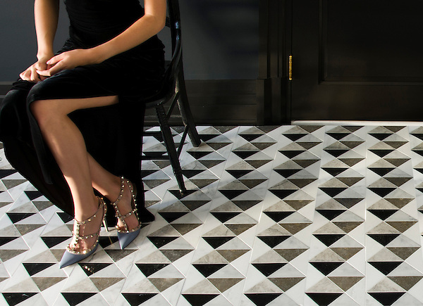Arbus, a hand-cut stone mosaic, shown in polished Soccoro Grey, Nero Marquina, Carrara, and honed Cavern, is part of the Palazzo collection by New Ravenna.