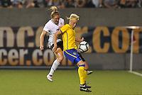 Rachel Buehler, Linnea Liljegard #11...USWNT tied Sweden 1-1 at Morrison Stadium, Omaha Nebraska.