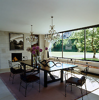 Sunlight pours into the dining room through the large picture windows with views across the garden