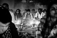 During Kartik, &ldquo;the holiest month&rdquo; beginning every year with the new moon in November, thousands of Hindu devotees celebrate the feast of Rakher Upobash, fasting and praying the gods sitting before the Shri Shri Lokanath Brahmachari Ashram, among the Swami Bagh Temple near Dhaka, Bangladesh. The worshippers offer candles called Prodip, meditate, give to charity, and generally perform austerity. <br /> The faithful pray while thick clouds of incense raise into the air.<br />  Barodi, Dhaka, Bangladesh. Nov. 11, 2014