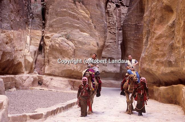 King Abdullah II of Jordan with journalist Peter Greenberg on camelback tour of Petra.