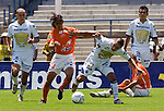 UNAM Pumas striker Fernando Morales (3rd L) fights for the ball with Chiapas Jaguares defender Gabriel Palmeros as Pumas defenders Dario Veron (L) and Chiapas Jehu (R) look on during their soccer match at the University Stadium, April 02, 2006. UNAM Pumas won 2-1 to Chiapas Jaguares... Photo by © Javier Rodriguez