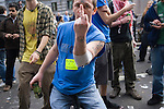 Stop the City march and demonstration against capitalism April 1st City of London while G20 World Leaders Summit meet in London. 2009. Protestors dance in Threadneedle Street. Credit crunch Burn a Banker sticker one finger salute.
