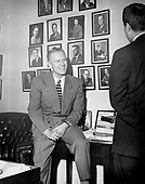 Ann Arbor, MI - FILE -- United States Representative Gerald R. Ford, Jr. (Republican of Michigan), talks to an unidentified visitor in his House Office.  Date: 1950<br /> Credit: Courtesy Gerald R. Ford Library via CNP