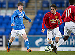 St Johnstone Academy v Manchester United Academy....17.04.15   <br /> Paul Simpson is closed down by Calum Whelan<br /> Picture by Graeme Hart.<br /> Copyright Perthshire Picture Agency<br /> Tel: 01738 623350  Mobile: 07990 594431