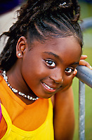 Young girl enjoying the New Orleans Jazz and Heritage Festival, New Orleans, Louisiana USA