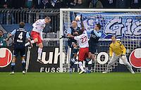 Fussball 2. Bundesliga:  Saison   2012/2013,    14. Spieltag  TSV 1860 Muenchen - 1. FC Koeln  16.11.2012 TOR zum 0:1 durch Kevin Mc Kenna (li, 1. FC Koeln) gegen Necat Ayguen (1860 Muenchen) und Torwart Gabor Kiraly (1860 Muenchen)