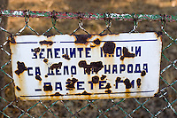 "Park sign  from the time of the Communists. It reads, ""The green areas are created by the people, protect them!"" Scene from a village, Stracin, Bulgaria, 2005"