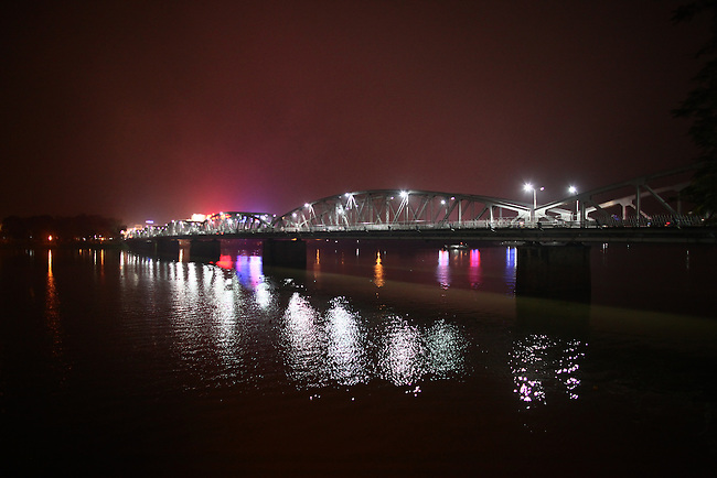 A bridge over the Perfume River is illuminated at night in Hue, Vietnam. Dec. 27, 2012.