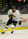 30 December 2007: University of Vermont Catamounts' defenceman Josh Burrows, a Freshman from Prairie Grove, IL, in action against the Quinnipiac University Bobcats at Gutterson Fieldhouse in Burlington, Vermont. The Bobcats defeated the Catamounts 4-1 to win the Sheraton/TD Banknorth Catamount Cup Tournament...Mandatory Photo Credit: Ed Wolfstein Photo