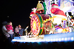 "Kevin Sawyer of Los Altos, far right, shows his granddaughter, Brady, the ""Ferris Wheel"" float before the start of the Festival of Lights Parade."