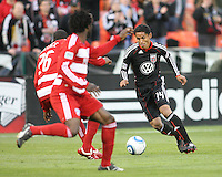 Andy Najar #14 of D.C. United moves towards Anthony Wallace #26 of F.C. Dallas during a US Open Cup match on April 28 2010, at RFK Stadium in Washington D.C. United won 4-2.