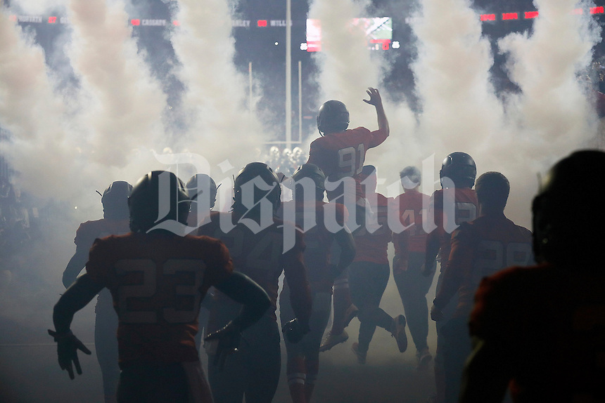 Ohio State Buckeyes players take the field with throwback uniforms inspired by the 1916 team prior to the NCAA football game against the Nebraska Cornhuskers at Ohio Stadium in Columbus on Nov. 5, 2016. (Adam Cairns / The Columbus Dispatch)