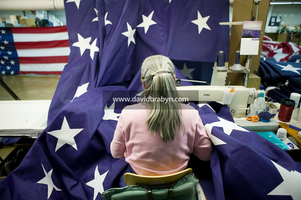 21 June 2005 - Oaks, PA - Leonor Ebba assembles parts of an American flag at the Annin & Co. flag manufacturing plant in Oaks, PA. Photo Credit: David Brabyn.