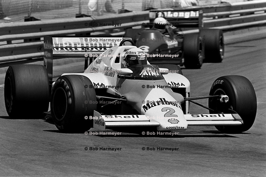 DETROIT, MI - JUNE 23: Alain Prost drives the McLaren MP4-2B/TAG TTE PO1 during the Detroit Grand Prix FIA Formula One World Championship race at the Detroit Street Circuit in Detroit, Michigan, on June 23, 1985.