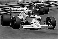 DETROIT, MI - JUNE 23: Alain Prost drives the McLaren MP4-2B/TAG TTE PO1 during the Detroit Grand Prix FIA Formula One World Championship race at the Detroit Street Circuit in Detroit, Michigan, on June 23, 1985.