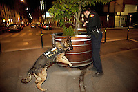 Switzerland. Geneva. Paquis neighborhood. A police officer and his dog search at night for hidden illegal substances (drugs). 10.05.12 &copy; 2012 Didier Ruef..
