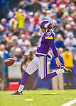 19 October 2014: Minnesota Vikings punter Jeff Locke kicks to the receiving Buffalo Bills in the second quarter at Ralph Wilson Stadium in Orchard Park, NY. The Bills defeated the Vikings 17-16 in a dramatic, last minute, comeback touchdown drive. Mandatory Credit: Ed Wolfstein Photo *** RAW (NEF) Image File Available ***