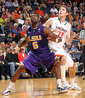 Jan. 2, 2011; Charlottesville, VA, USA; LSU Tigers forward Malcolm White (5) looks for the rebound with Virginia Cavaliers forward Will Sherrill (22) during the game at the John Paul Jones Arena. Virginia won 64-50. Mandatory Credit: Andrew Shurtleff-
