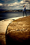 Woman standing at quayside
