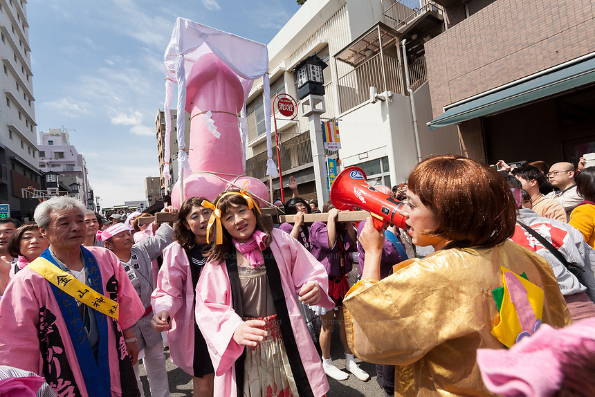 The Kanamara matsuri or festival of the Steel phallus Kawasaki Daishi, Kawasaki, Kanagawa, Japan. Sunday, April 2nd 2017. The Kanamara Penis festival takes place on the first Sunday of April and celebrates the local legend of a penis eating demon who was defeated after being tricked into biting a steel phallus. The festival is popular with Japan's gay community and now uses its notoriety to raise money for HIV and AIDS charities. It is also wildly popular with foreign and Japanese.tourists.