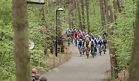 peloton through the forest around the lake at the Tom Boonen farewell race/criterium 'Tom Says Thanks!' in Mol/Belgium