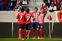 Erick Torres (9) of Chivas USA celebrates scoring with teammates during a Major League Soccer (MLS) match against the New York Red Bulls at Red Bull Arena in Harrison, NJ, on March 30, 2014.