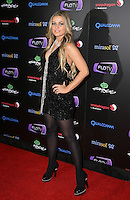 CARMEN ELECTRA .At SWAGG VIP Kid Rock Concert at the Joint inside the Hard Rock Hotel and Casino, Las Vegas, Nevada, USA,.7th January 2010..full length black sleeveless dress tights necklace platform shoes pearls beads hand on hip heels .CAP/ADM/MJT.© MJT/AdMedia/Capital Pictures.