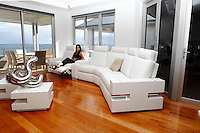 Obelli Design custom built white leather couch with electric foot stools and matching table.
