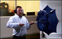 BNPS.co.uk (01202 558833)<br /> Pic: Rainshader/BNPS<br /> <br /> ***Please use full byline***<br /> <br /> Stephen testing a conventional brolley in the wind tunnel at Coventry University.<br /> <br /> A wet day out at the Grand National last year has led to British inventor Stephen Collier reinventing the umbrella.<br /> <br /> Stephen was so depressed by his soaking wet visit to Aintree that he set his mind to creating an umbrella that would not poke peoples eyes out or turn inside out at the first puff of wind.<br /> <br /> Now after extensive research and even a visit to a wind tunnel Stephen's revolutionary design is set to go on sale.<br /> <br /> The Rainshader will cost &pound;24.99 but will last a lot longer than some of the flimsy versions on sale today.