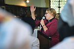 The Rev. Kirsten Fryer speaks to participants in a worship service of Nuer refugees from South Sudan who live in Cairo, Egypt. The service took place at St Andrews United Church of Cairo.